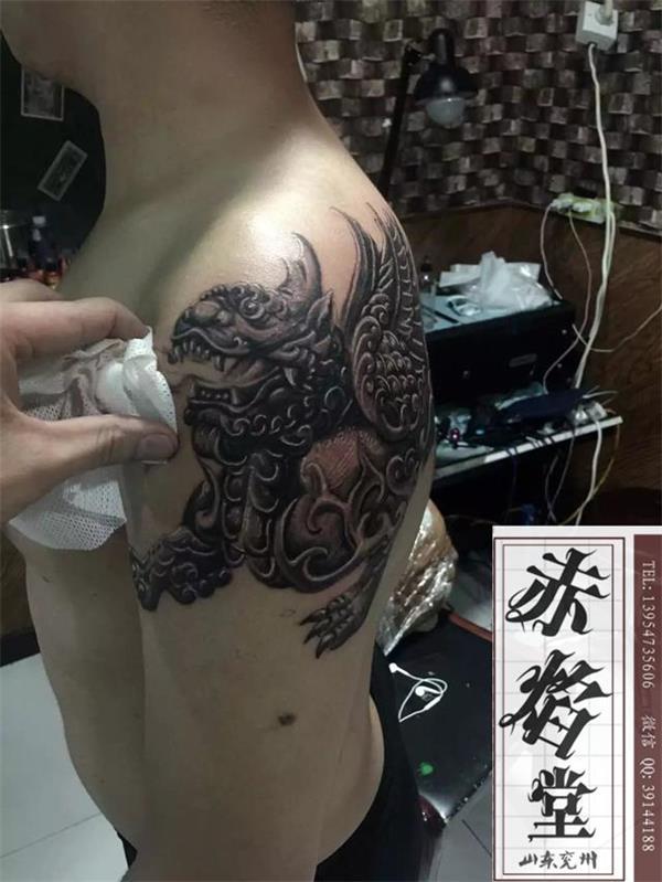 济南纹身 大臂麒麟纹身 山东兖州赤焰堂纹身店